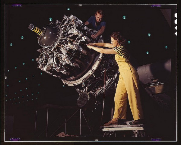 woman works on aircraft motor